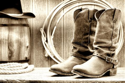 American West Rodeo Cowboy Boots At Old Ranch Barn Stock